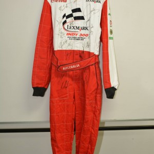 2004 Lexmark Indy 300 promotional race suit signed by the WHOLE grid